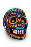 Beaded skull  on white. Colorful skull from mexican traditional huichol bead art, symbol of the day of the dead Stock Images