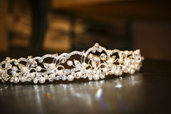 Beaded tiara on black surface Royalty Free Stock Images