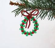 Beaded wreath. Christmas ornament on tree branch stock images