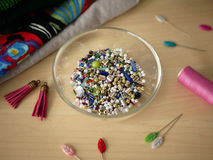 Beading and sewing tools in the backround Royalty Free Stock Images