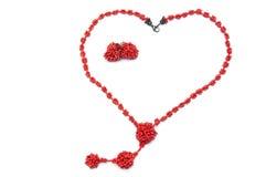 beads örhängehjärtaform arkivbilder