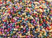 Beads. Many colorful plastic beads on a white background Royalty Free Stock Image