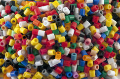 Beads. Many colorful plastic beads on a white background Stock Image