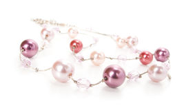Beads. Pink beads on white background Royalty Free Stock Photos