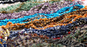 Beads. A lot of beads with focus on the center Royalty Free Stock Photos