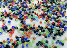 Beads. Spilled colourful beads Stock Photography