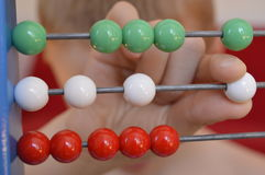 Beads on abacus Stock Photos