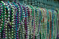 Beads aligned on fence in New Orleans in Lousiana after Mardi Gras Stock Image