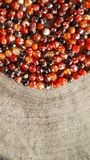 Beads of amber fireplace faceted agate on rough surface of an old stump. Vertical image 16x9 royalty free stock photos