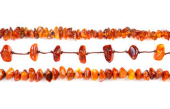 Beads of amber laid in a row Stock Photo