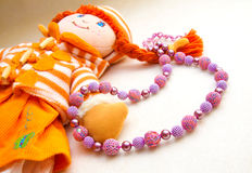 Beads on a background of dolls royalty free stock photo