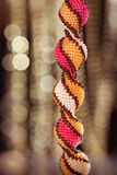 Beads, beadworks on a colored, accessories. Accessories for the neck, beautiful handmade Colored buseny bracelet and necklace royalty free stock photography