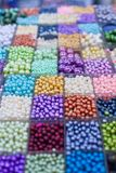 Beads in boxes Stock Image