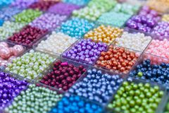 Beads in boxes. On a Thai sunday market Chatuchak. Bangkok. Thailand Royalty Free Stock Images