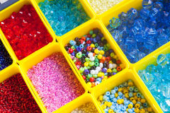Beads in boxes Stock Photo
