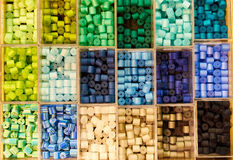 Beads in boxes Stock Images