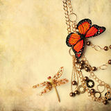 Beads with butterfly and dragonfly Stock Photography