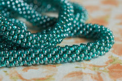 Beads of color the aquamarine connected in the form of a plait Stock Images