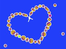 Beads in a colored strip. On a blue background in the shape of a love heart isolate Stock Photo