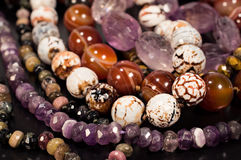 Beads of different stones close-up Stock Photography