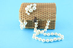 Beads and earrings in a wooden casket Royalty Free Stock Photos