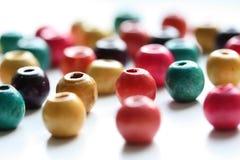 beads färgrikt trä Fotografering för Bildbyråer