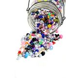 Beads in Glass Jar for Crafts Jewelry Royalty Free Stock Images