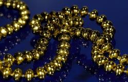 beads guld arkivfoto