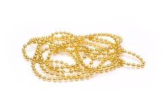 beads guld- Guld- sken Gul bakgrund Arkivfoto