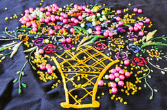 Beads on a hand-emboidered doily napkin. Beads on a colorful hand-emboidered doil napkin Stock Photography