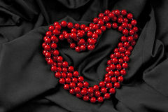 Beads in heart shape Stock Photos