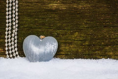 Beads and heart on wood Stock Photo
