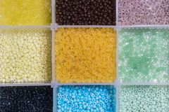 Beads for Jewelry Making. Color beads in the cells of square kit Stock Photo