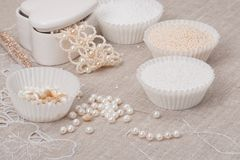 Beads Jewelry On Natural Linen Background. Hand Stock Photos