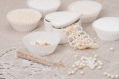 Beads Jewelry On Natural Linen Background. Hand Stock Images