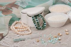 Beads Jewelry On Natural Linen Background. Hand Royalty Free Stock Photo