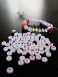 Beads with letters on them. Royalty Free Stock Image