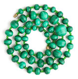 Beads made of malachite, rolled in a spiral Stock Images