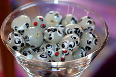 Beads in a Martini Glass. Google eye beads fill a martini glass Royalty Free Stock Image