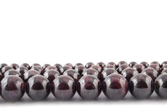Beads from natural gemstone garnet on white background Stock Images