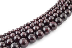 Beads from natural gemstone garnet on white background Stock Photos