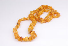 Beads, necklace of amber on white Stock Photos
