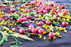 Beads and necklace on a knitted napkin Stock Images