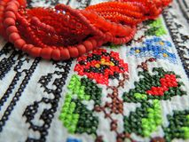 Beads necklace on ukrainian embroidery shirt. Royalty Free Stock Image