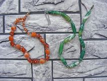 Beads and necklaces made of natural stone agate and amber royalty free stock photos