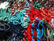 Beads and necklaces shining in the sun. Stock Photography