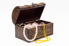Beads in an old wooden box. Isolated. Royalty Free Stock Photos