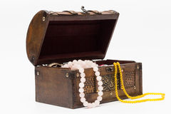 Beads in an old wooden box. Isolated. Royalty Free Stock Images