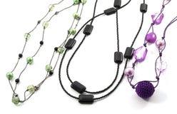 beads olikt exponeringsglas Arkivfoto
