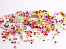 Beads and ring Stock Images